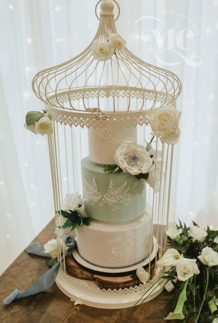 Vintage birdcage wedding cake with hand piped birds and floral designs by Mama Cakes Cumbria