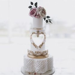 Carved heart wedding cake, sugar flowers, ruffles and gold details by Mama Cakes Cumbria