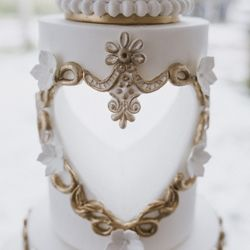 Wedding cake carved heart with gold details by Mama Cakes Cumbria
