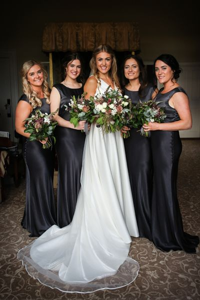 Black and mauve wedding theme - Bridesmaids in black dresses and the bride