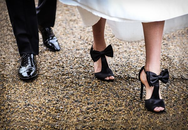 Black and mauve wedding theme - bride and groom black wedding shoes