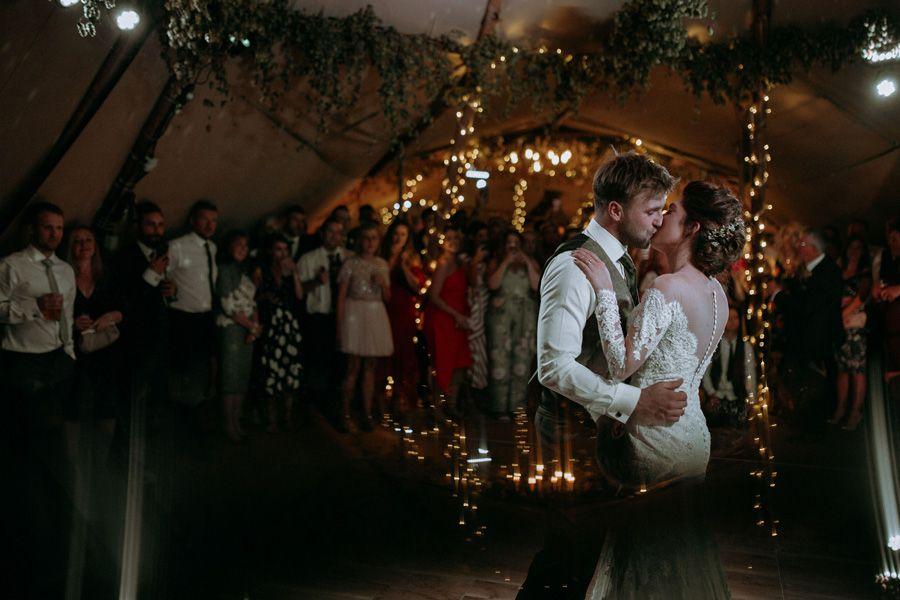 Romantic kiss in a tipi wedding